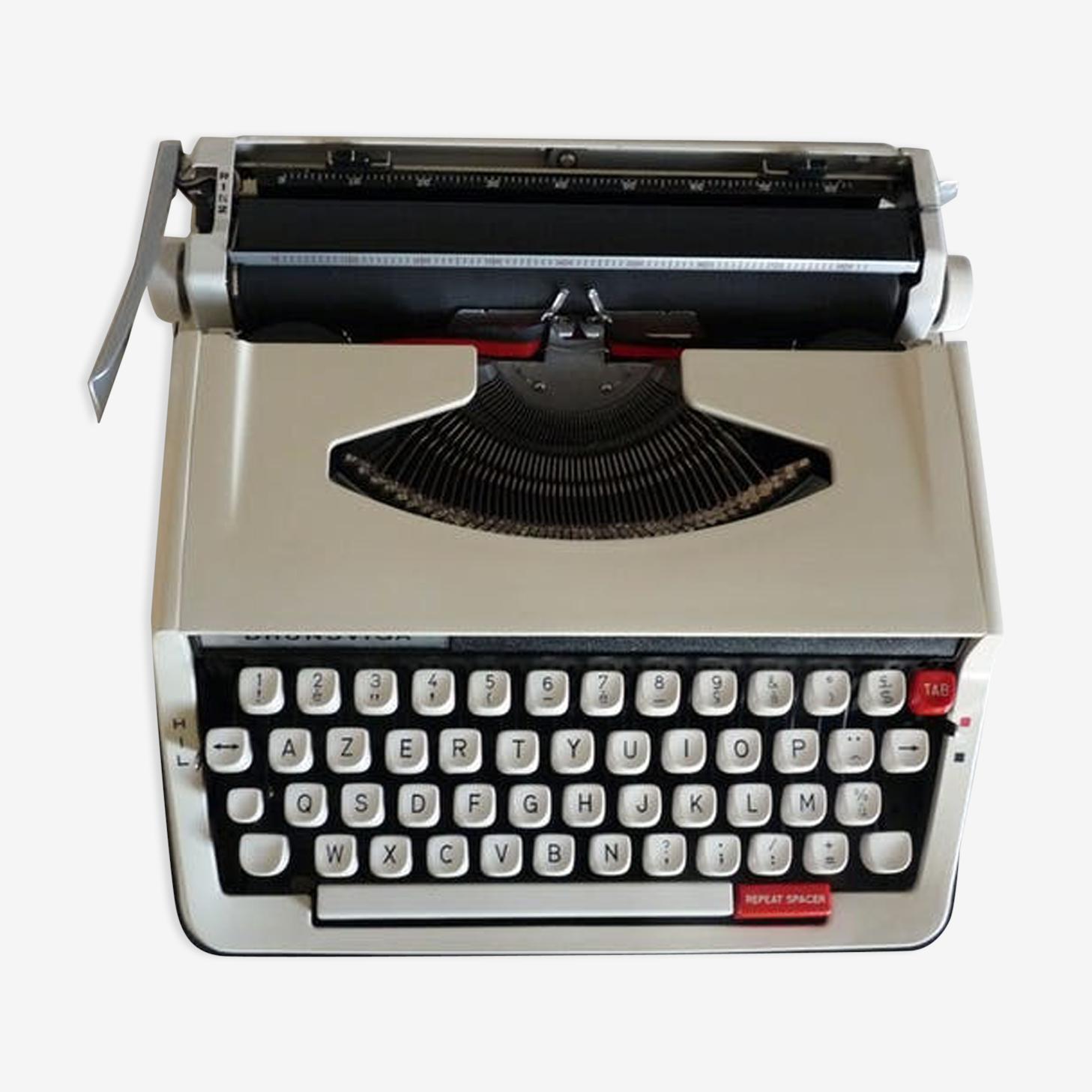Machine à écrire vintage Brunsviga avec son étui de transport