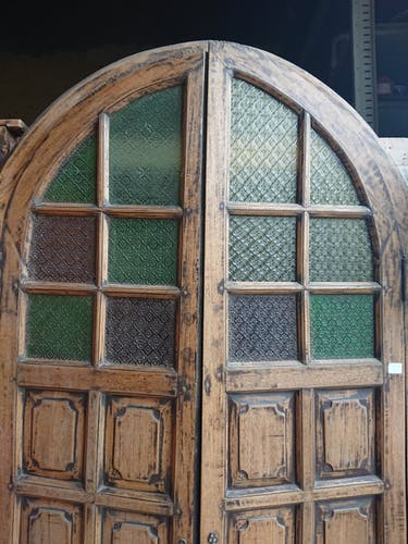 Ancient Indian door curved with colorful stained glass windows