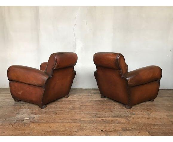 Paire de fauteuils club en cuir des années 1950