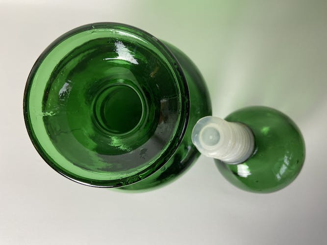 Green glass carafe