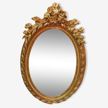 Grand miroir style Louis XVI en stuc doré