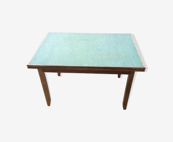 Table en bois massif et skaï vert