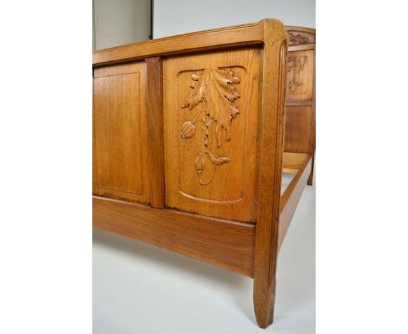 Art Nouveau carved oak bed, circa 1910