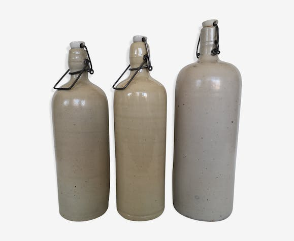 Trio of enamelled sandstone bottles