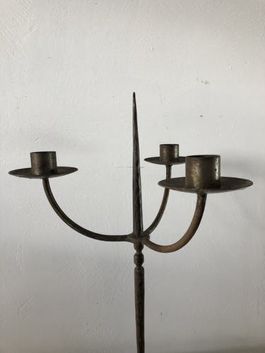 Old wrought iron candlestick