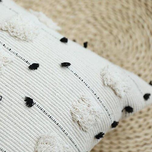Coussin à pompon coton 45x45 cm