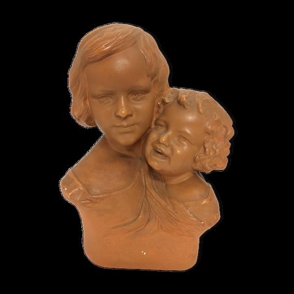 Buste en plâtre de petites filles art déco signé