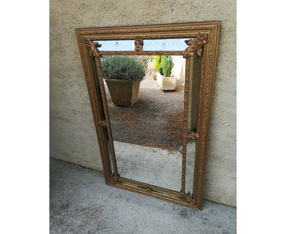 Golden mirror with parecloses
