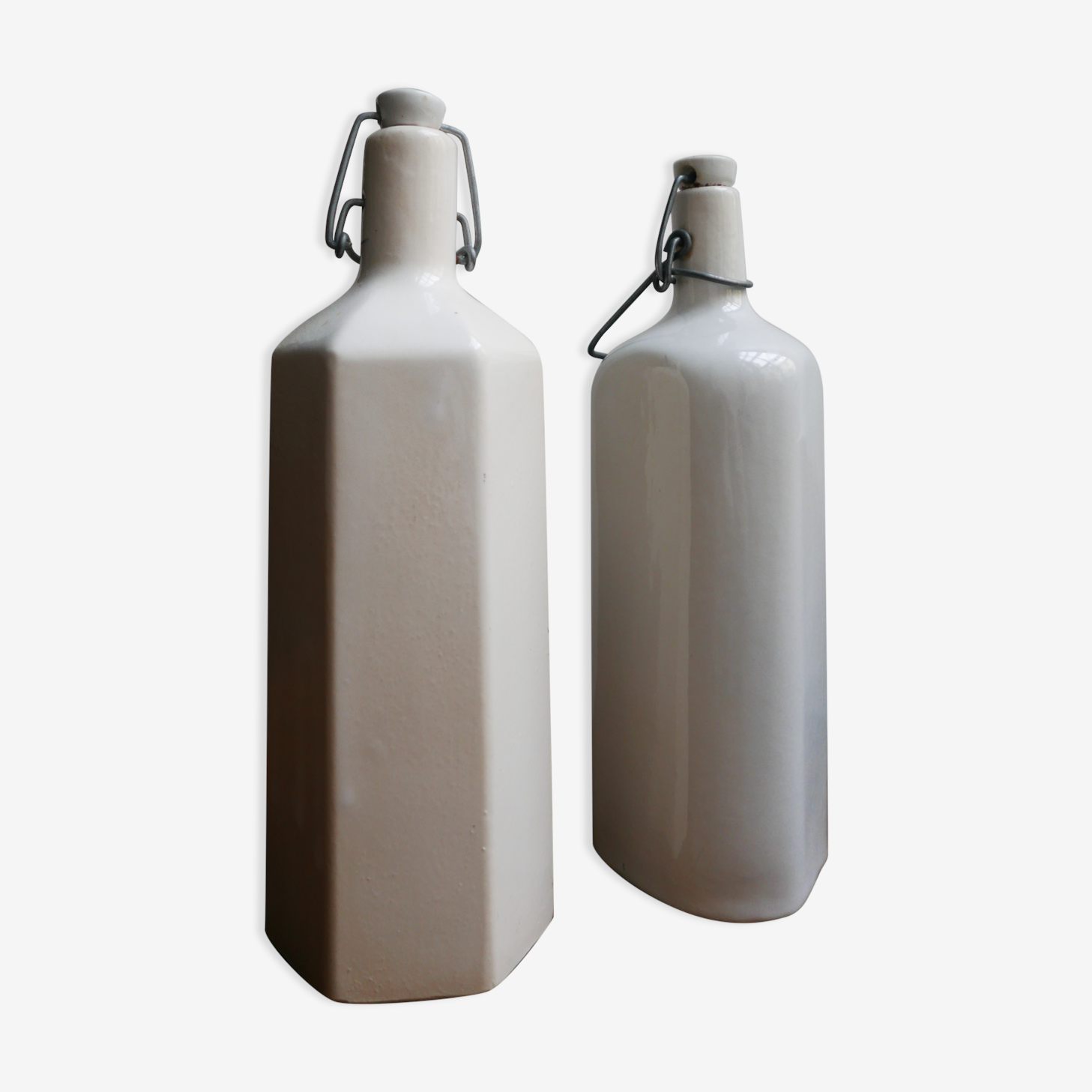 Lot of two old bottles in sandstone