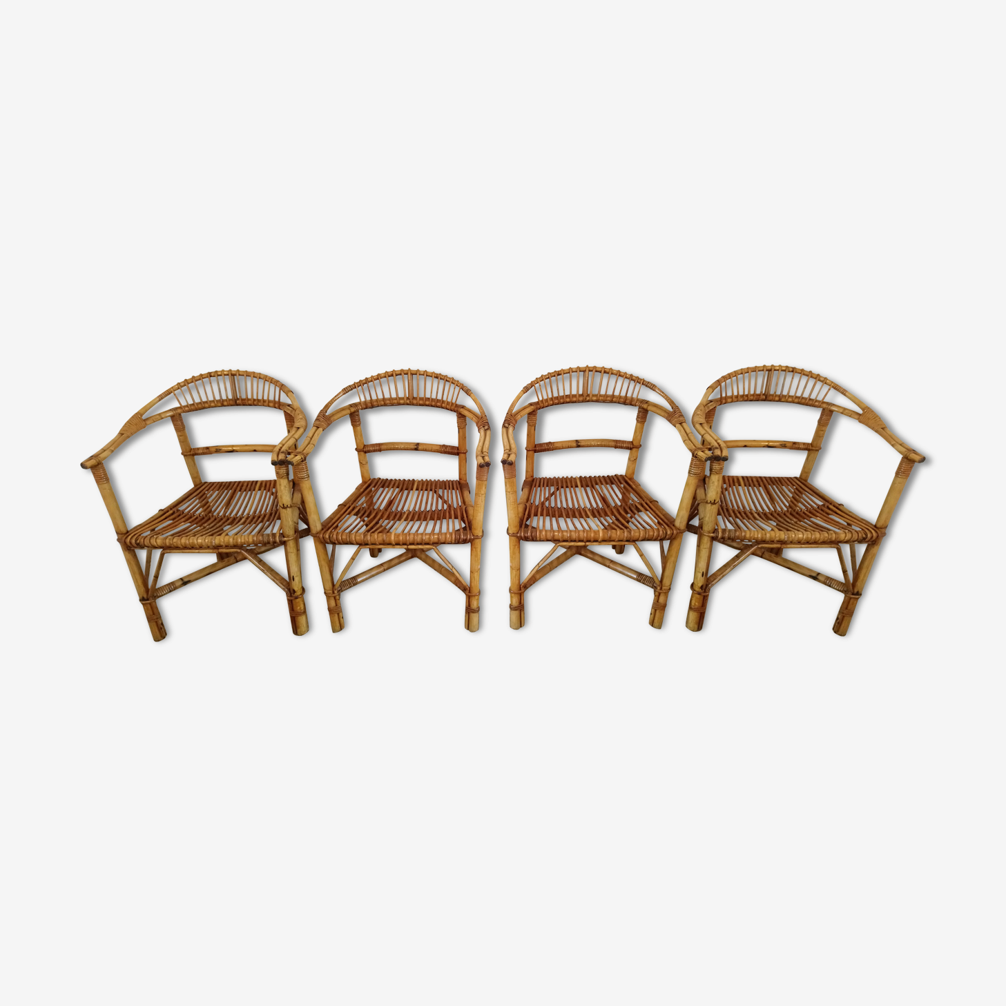 Suite of 4 rattan armchairs of the years 60