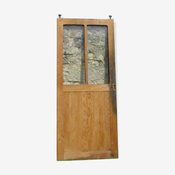 Old door of workshop glass - time early twentieth