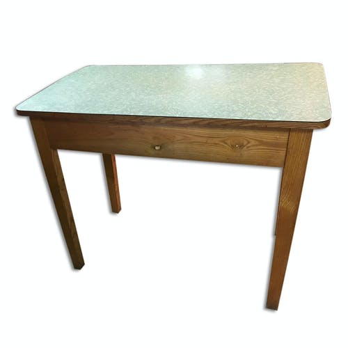An industrial table with a formica tray