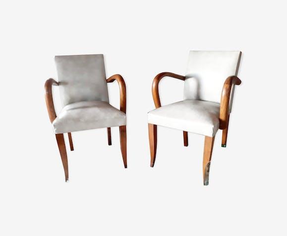 Paire de fauteuils en bois massif et skaï des années 50