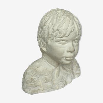 Child bust in plaster