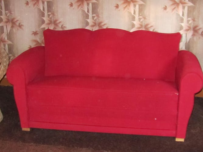 Vintage sofa bed in red fabric
