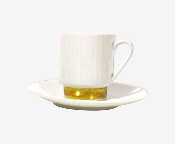 Cup of Melitta Hamburg with a cake plate
