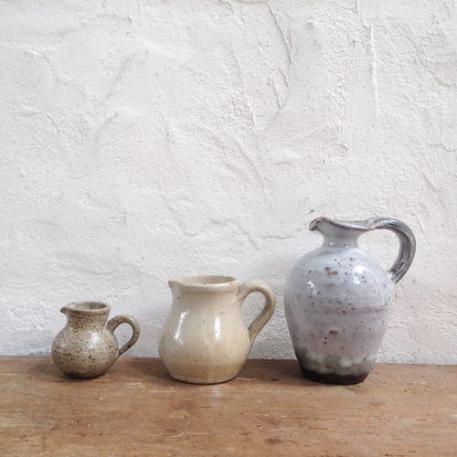 Trio of sandstone pitchers