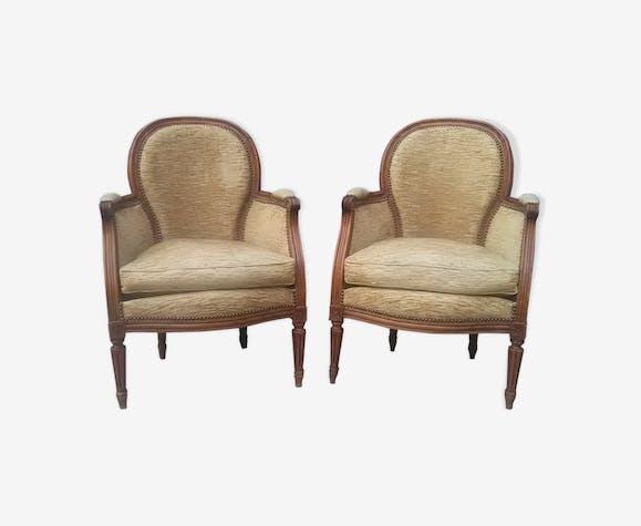 Paire de fauteuils bergère style Louis XVI