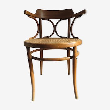 Curved wooden office armchair