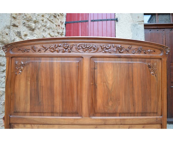 Floral Art Nouveau bed in carved walnut, France, circa 1905