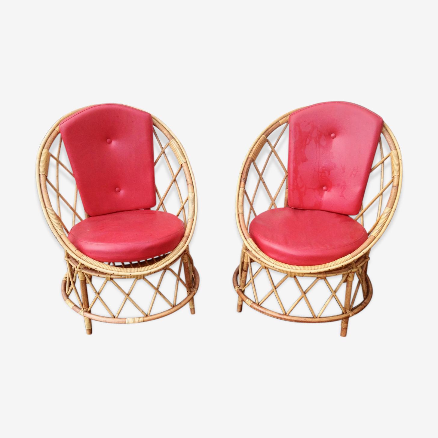 Paire de fauteuils en rotin années 60 avec galettes assises et dos en skaï rouge