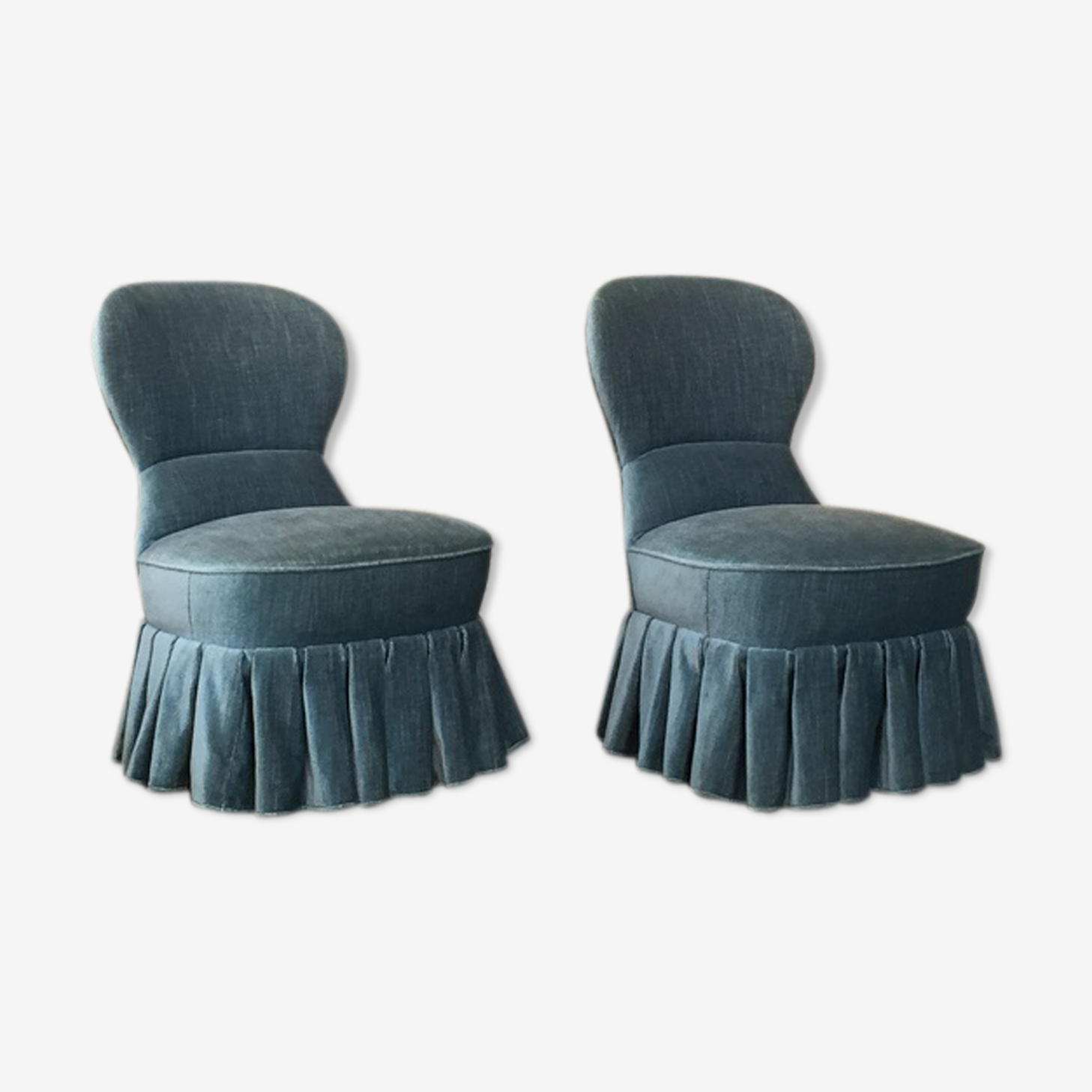 Pair of toad armchairs with blue-green velvet skirt