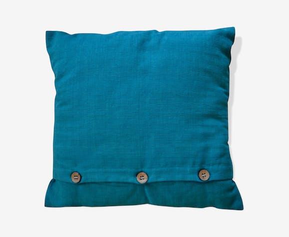 Scandinavian green cushion with wooden buttons