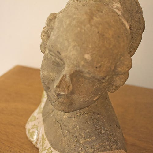 Woman bust in stone and enamel