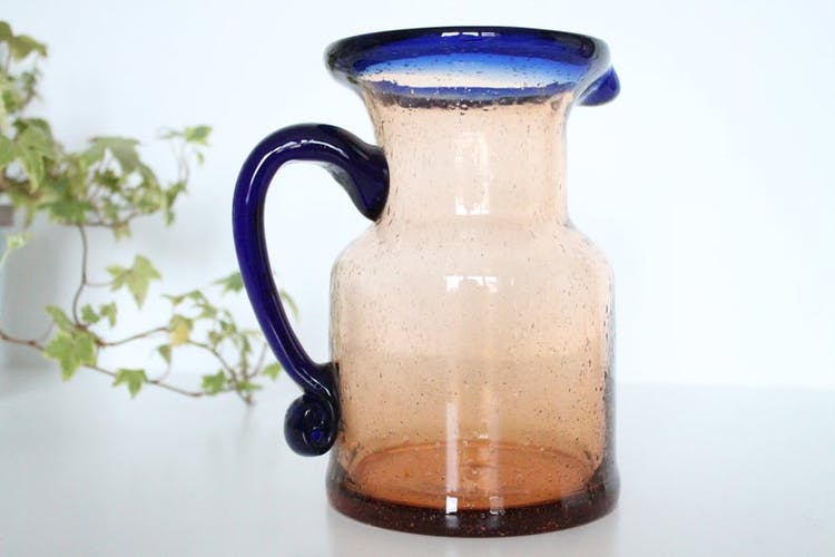 Bubble glass jug made by French craftsmen, blue and orange