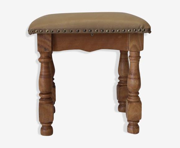Rustic stool on leather