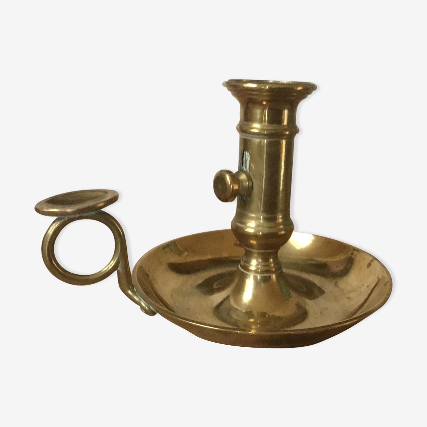 Thumb brass candlestick