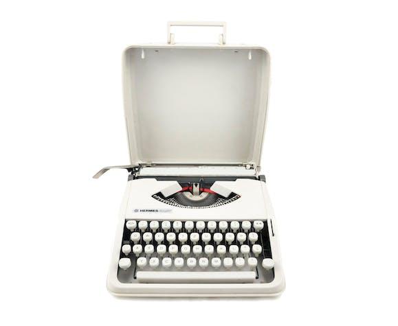 Machine à écrire Hermes Baby Gris perle vintage révisée ruban neuf