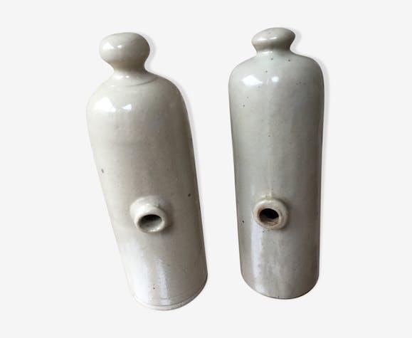 Lot of two old bottles of beige enamelled sandstone bottles