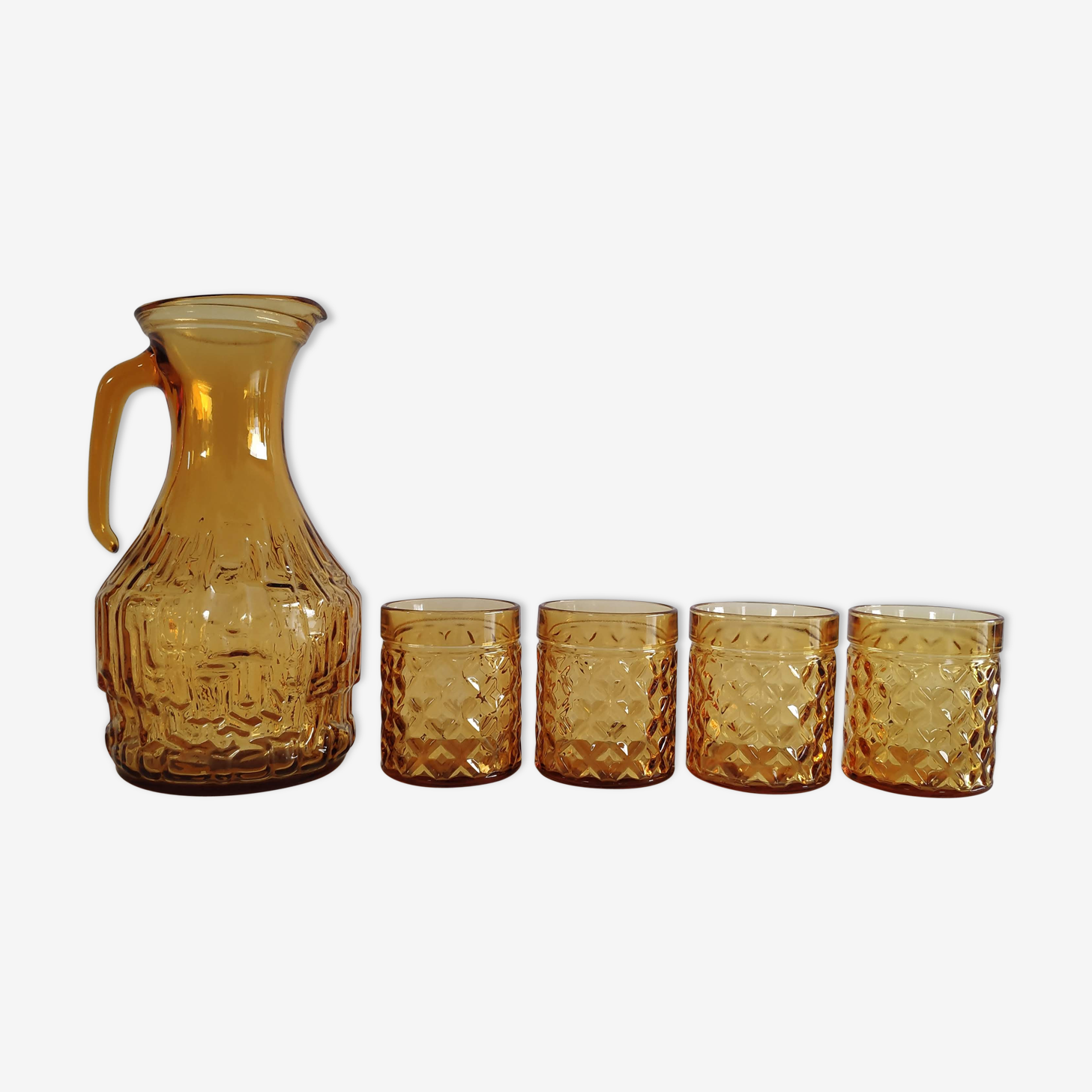 1 carafe et 4 verres en verre ambré années 60