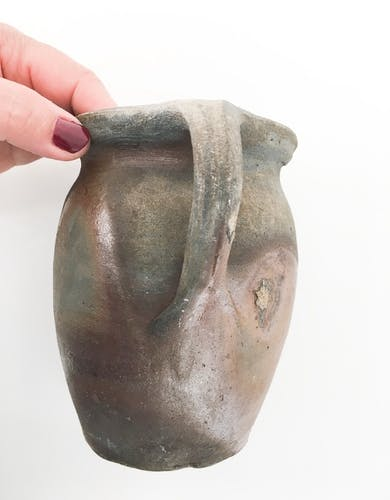 Old terracotta pot with handle