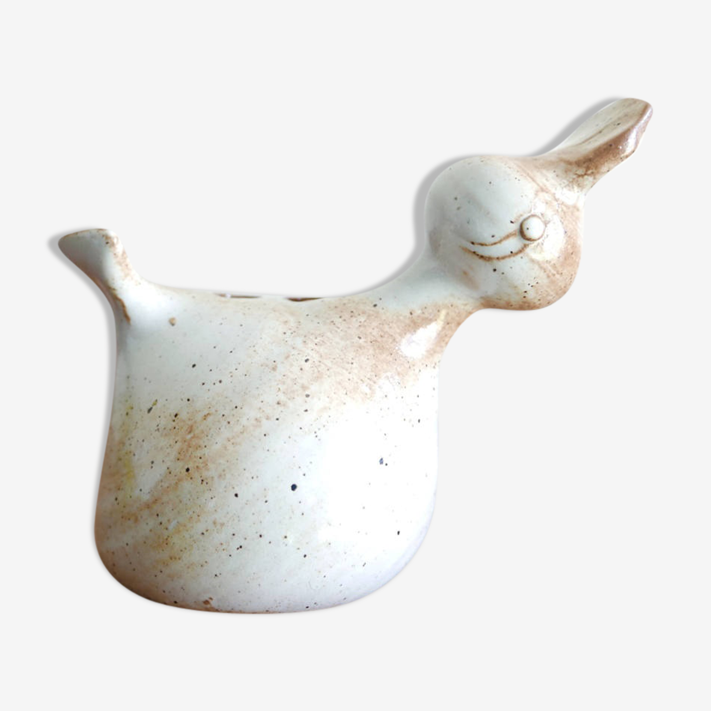 Pique flowers bird in sandstone of the pottery of the Marais, 50 years