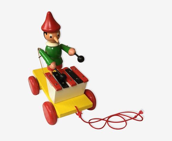 Ancien jouet à tirer Pinocchio et son xylophone