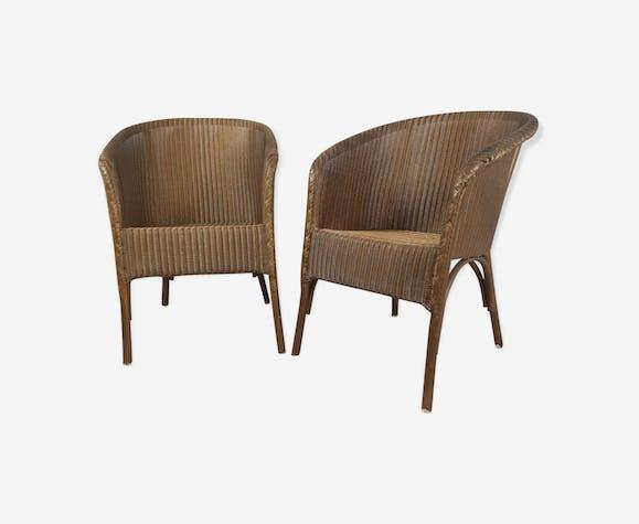 Paire de fauteuil Lloyd Loom doré