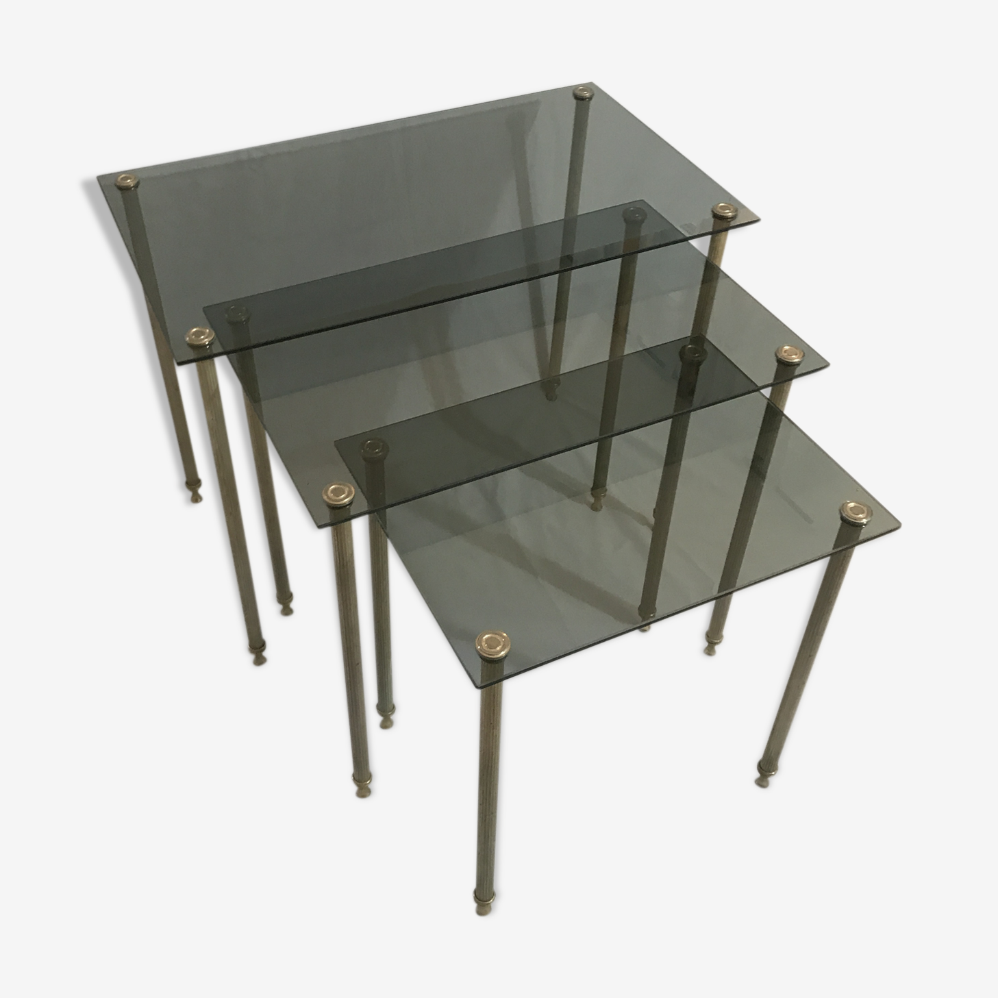 Pull-out tables in gold metal and smoked glass 1970