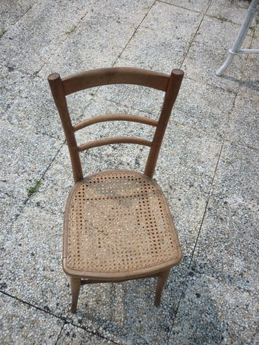 Wooden bistro style cane chair