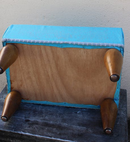 Wooden foot rest and blue fabric