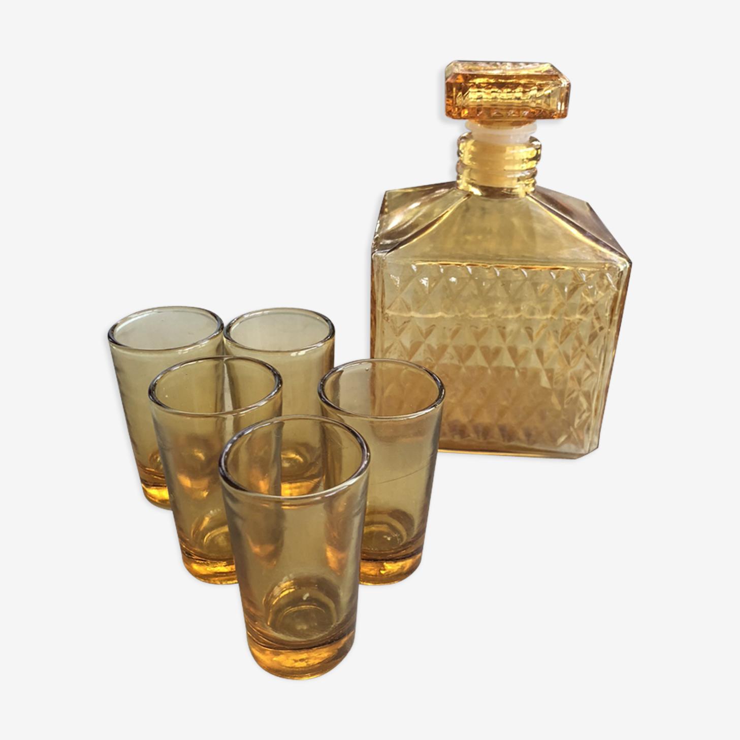 Carafe en verre ambrée et 5 verres