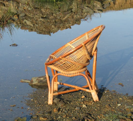 Fauteuil coquille en rotin
