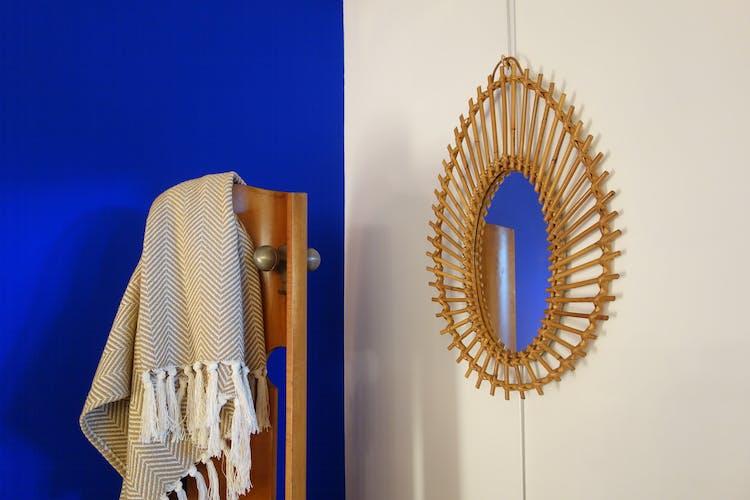 Free-form sun mirror in 60s rattan