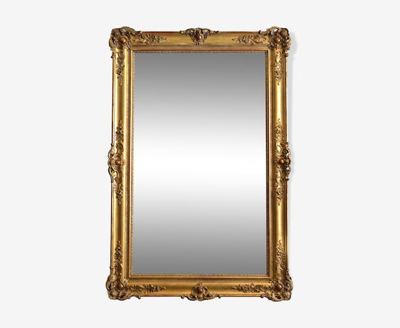 Nineteenth century monumental mirror in gilded wood