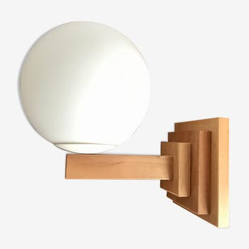Wood and frosted glass sconce