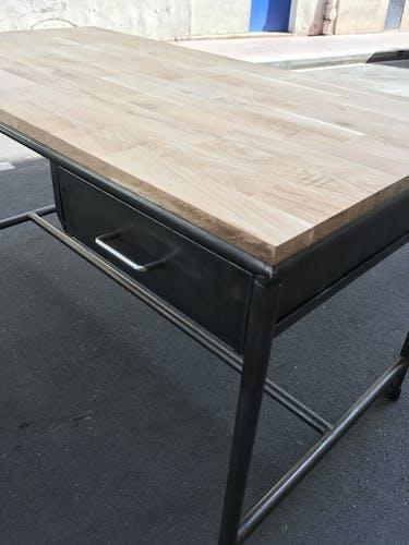Metal desk on wood circa 1950