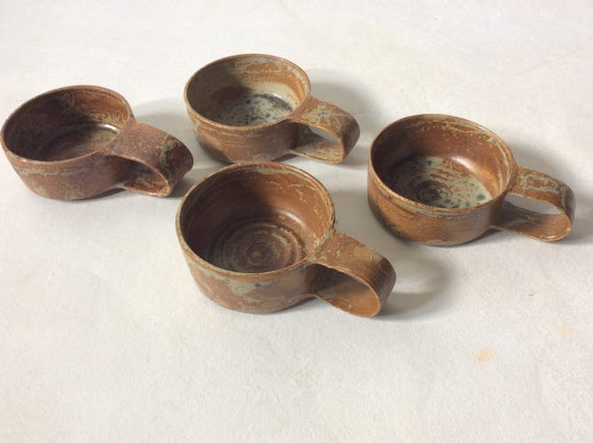 Raw sandstone cups