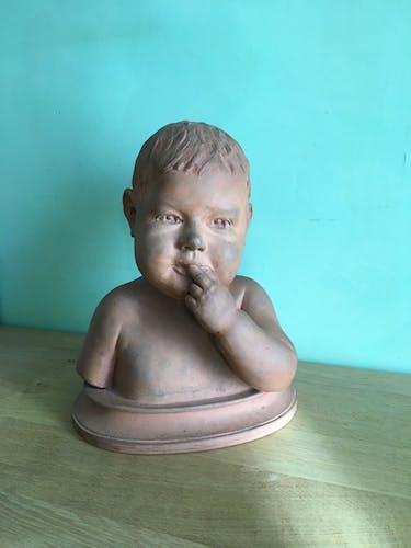 Buste d'enfant en terre cuite