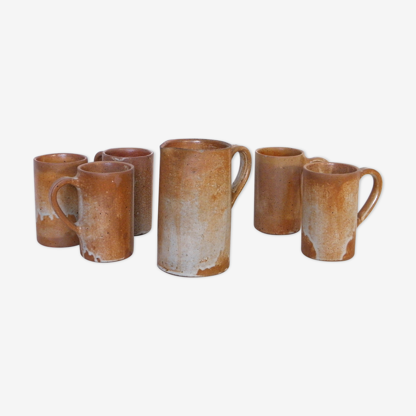 Decanter and enamelled stoneware mugs